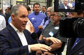 EPA Administrator Scott Pruitt, talks to a reporter after speaking at Whayne Supply in Hazard, Kentucky, Oct. 9, 2017.  Pruitt says the Trump administration will abandon the Obama-era clean power plan aimed at reducing global warming.