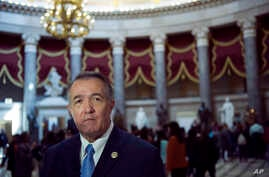 Rep. Trent Franks, R-Ariz. walks through Statuary Hall on Capitol Hill in Washington, March 24, 2017.