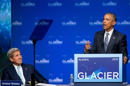 President Barack Obama, right, accompanied by Secretary of State John Kerry, left, speaks at the Global Leadership in the Arctic: Cooperation, Innovation, Engagement and Resilience (GLACIER) Conference at Dena'ina Civic and Convention Center in Ancho