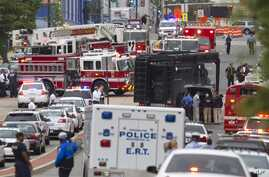 A Emergency Response Team vehicle arrives to the scene where a gunman was reported at the Washington Navy Yard in Washington, Sept. 16, 2013.