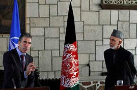 NATO Secretary-General Anders Fogh Rasmussen (l) during a joint press conference with Afghan President Hamid Karzai at the presidential palace in Kabul, March, 4, 2013.