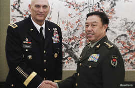 U.S. Army Chief of Staff General Ray Odierno (L) shakes hands with Fan Changlong, vice chairman of China's Central Military Commission, at Bayi Building in Beijing February 21, 2014. REUTERS/Lintao Zhang/Pool (CHINA - Tags: POLITICS MILITARY) - RTX19