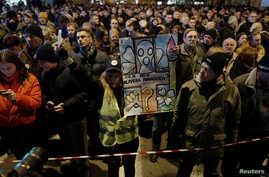 People attend a march on the first anniversary of the murder of opposition Serb politician Oliver Ivanovic, in Belgrade, Serbia Jan. 16, 2019.