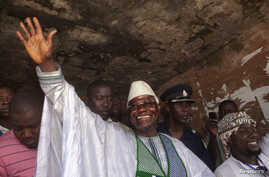Sierra Leone's incumbent President Ernest Bai Koroma waves to supporters after voting in the capital, Freetown, November 17, 2012.