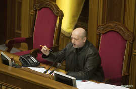 Newly-elected speaker of parliament Oleksander Turchynov, who on Sunday assumed interim presidential powers, is seen in the parliament building in Kyiv February 22, 2014.