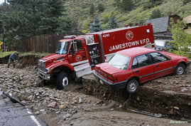 A rescue vehicle is seen stuck in the mud in Jamestown, Colorado, after a flash flood destroyed much of the town, September 14, 2013.