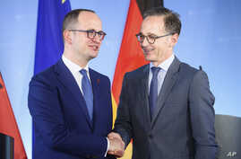 German Foreign Minister Heiko Maas (R) and his counterpart from Albania, Dimitir Bushati (L) shake hands after a joint press conference after a meeting at the foreign ministry in Berlin, Germany, July 30, 2018.