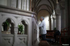 A woman prays at Sheshan Cathedral in the outskirts of Shanghai, October 28, 2013.