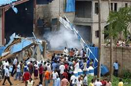 Scene outside outside a church following a blast in Kaduna, Nigeria, June 17, 2012