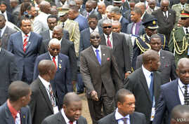 Zimbabwe's President Robert Mugabe (C), Mozambique's President Armando Guebuza (2nd L red tie), Swaziland's King Mswati III (L red and white tie) and Congo's President Joseph Kabila (behind Guebuza) arrive with other regional leaders for a summit of