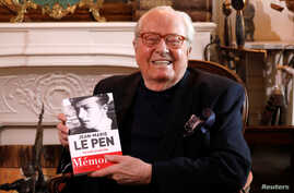 Jean-Marie Le Pen, founder of France's far-right National Front political party, holds his book of memoirs in Montrerout, France, Feb. 27, 2018.