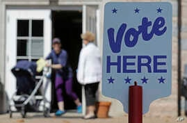 FILE - Voters leave a polling station in Charlotte, North Carolina, May 8, 2018.