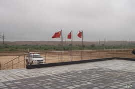 Chinese flags flutter atop the coal-mining site in Islamkot, Tharparkar.