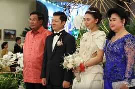 Prime Minister Hun Sen and his wife in picture with Sok Sokan, the son of the late Council of Ministers President Sok An, and Sam Ang Leakhena whose parents own Vattanac Capital on their wedding day in June. (Web Screenshot)