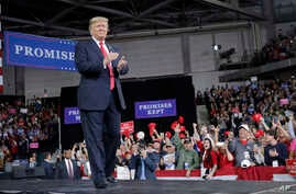 President Donald Trump walks toward his podium to begin speaking at a campaign rally at Kansas Expocentre, Oct. 6, 2018 in Topeka, Kan.