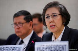 Special Rapporteur on the situation of human rights in Myanmar, Yanghee Lee (R) gives her report during the Human Rights Council at the United Nations in Geneva, Switzerland, March 12, 2018.
