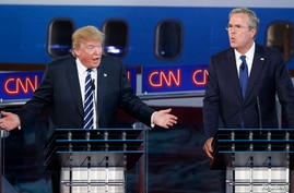 Republican U.S. presidential candidates businessman Donald Trump and former Florida Governor Jeb Bush talk simultaneously during the second official Republican presidential candidates debate.