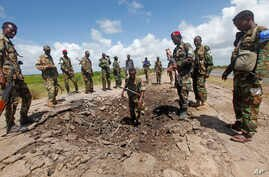 FILE - Somali soldiers stand at a Somali military base, near the site of an attack by al-Shabab, in Lower Juba, June 13, 2018. The base was the target of another al-Shabab assault Monday.