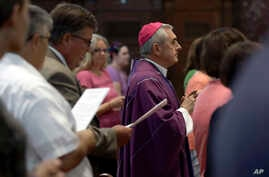FILE - Bishop Ronald Gainer, of the Harrisburg Diocese, arrives to celebrate mass at the Cathedral Church of Saint Patrick in Harrisburg, Pa., Aug. 17, 2018. Gainer is named in a grand jury report on rampant sexual abuse by Roman Catholic clergy.