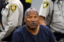 FILE - In this May 14, 2013, file photo, O.J. Simpson sits during a break during a hearing in Clark County District Court in Las Vegas. Simpson, the former football star, TV pitchman and now Nevada prison inmate, is seeking his release after more tha