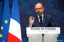 """French Prime Minister Edouard Philippe delivers a speech during the presentation of the """"Great National Debate"""" findings, called to quell the anger of French """"yellow vests"""" movement, at the Grand Palais in Paris, France, Apr. 8, 2019."""