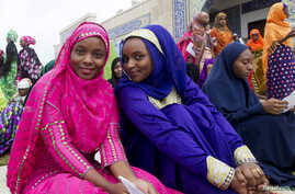 Muslim women pose for photographs after the Eid al-Fitr prayers at the International Centre for Islamic Culture and Education in Abuja, August 8, 2013.