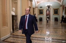 Sen. Chris Coons, D-Del., arrives at the Capitol in Washington, Nov. 14, 2018, as he and Sen. Jeff Flake, R-Ariz., prepare to call for a floor vote to protect Special Counsel Robert Mueller after President Donald Trump forced the resignation of  Atto