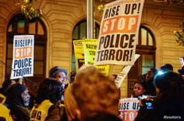 FILE - Protestors gather outside of the courthouse on the first day of jury selection for Baltimore Police Officer William Porter who is  charged in connection with the death of Freddie Gray, in Baltimore, Md., Nov. 30, 2015.