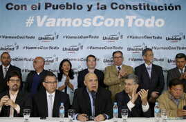 Jesus Torrealba (C), secretary of Venezuela's coalition of opposition parties (MUD), talks to the media next to his fellow politicians during a news conference in Caracas, March 8, 2016.