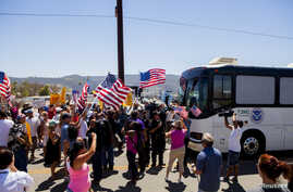 Demonstrators block the buses carrying the undocumented, who were scheduled to be processed at the Murrieta Border Patrol Station in Murrieta, California, July 1, 2014.