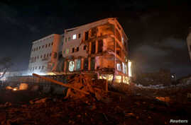 A damaged building is seen at the scene where a car bomb exploded targeting a Mogadishu hotel in a business center in Maka Al Mukaram street in Mogadishu, Somalia, Feb. 28, 2019.