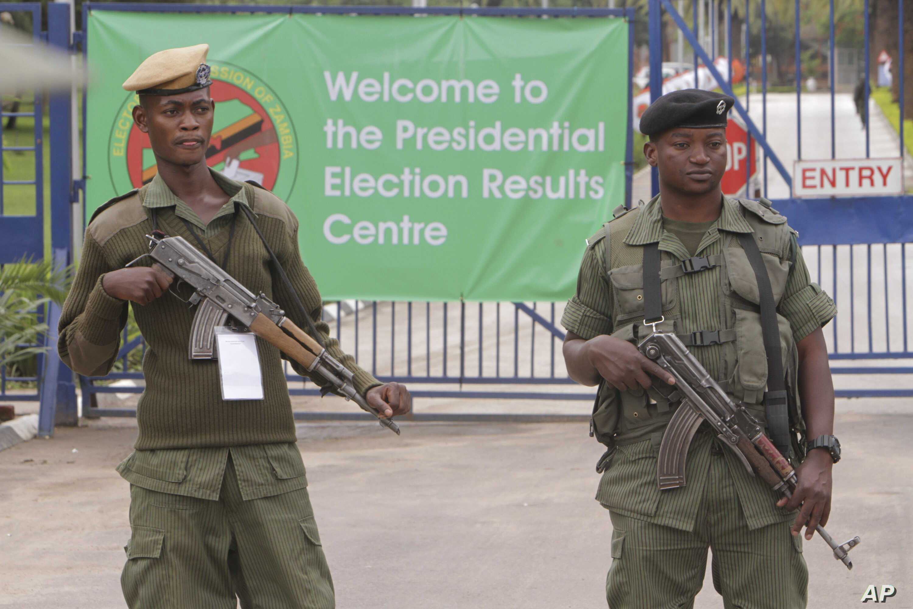 FILE - Armed police officers stand guard outside the presidential election results center in Lusaka, Zambia, Jan, 21, 2015.