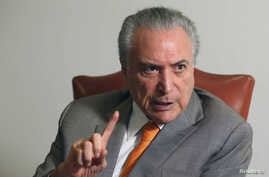 Brazil's President Michel Temer, gestures during an interview with Reuters at his office in Brasilia, Brazil, Jan. 16, 2017.