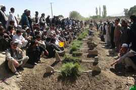 The victims of a deadly mosque attack in Gardez, the capital of Paktia province, eastern Afghanistan, Aug. 3, 2018, were buried in a common grave Saturday under tight security.