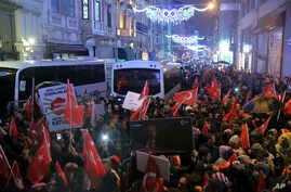 Supporters of Turkey's President Recep Tayyip Erdogan wave flags outside the Dutch consulate to protest, in Istanbul, March 12, 2017.