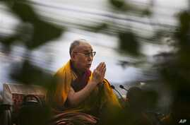 Dalai Lama prays during Ganden Ngachoe, the death anniversary of 14th Century Tibetan Saint-Scholar, Lama Tsongkhapa in New Delhi, India, Dec. 16, 2014.