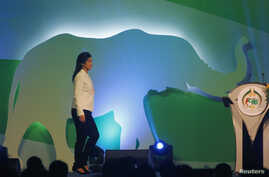 Thailand's Prime Minister Yingluck Shinawatra is seen walking on stage before opening the CITES meeting in Bangkok March 3, 2013.