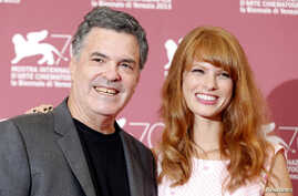 """Director Amos Gitai (L) poses with actress Yuval Scharf during a photocall for the movie """"Ana Arabia"""" during the 70th Venice Film Festival in Venice Sept. 3, 2013."""