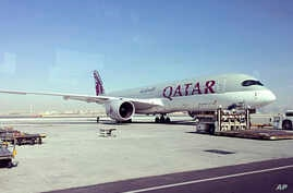 FILE - This June 6, 2017, file photo shows a parked Qatari plane in Hamad International Airport in Doha, Qatar. The United Arab Emirates orchestrated the hacking of a Qatari government news site in May, planting a false story that was used as a prete