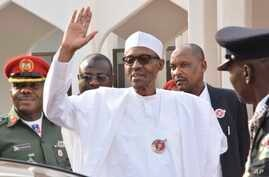 Nigeria President Muhammadu Buhari, waves after a meeting in Abuja, Nigeria, Jan. 9, 2017. Officials say Nigeria's President Muhammadu Buhari will lead three West African heads of state to Gambia on Wednesday in an effort to persuade its longtime lea