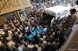A five-year-old rape victim is moved to the All India Institute of Medical Sciences hospital from Swami Dayanand hospital for treatment in New Delhi April 19, 2013. The girl's rape by a male neighbor, according to the police, triggered an angry prote
