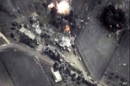 In this photo made from the footage taken from Russian Defense Ministry official web site on Oct. 1, 2015 a bomb explosion is seen in Syria.