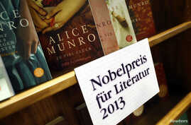 FILE - Books by Canadian writer Alice Munro, the 2013 Nobel Prize in Literature winner, are displayed during the book fair in Frankfurt, Oct. 10, 2013.