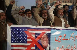 Pakistani traders protest against U.S. President Donald Trump in Peshawar, Pakistan, Jan 5, 2018.
