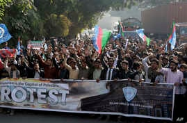 Supporters of a Pakistani religious party rally against United States in Lahore, Pakistan, Dec. 8, 2017. Hundreds of Islamists have rallied in major cities of Pakistan, condemning U.S. President Donald Trump for declaring Jerusalem as Israel's capita