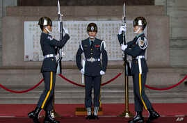 Members of the Taiwanese honor guard take part in a change of duty ceremony at the Chiang Kai-shek Memorial Hall in Taipei, Taiwan, Jan. 15, 2016.