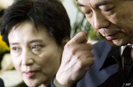 Gu Kailai, left, wife of then Chinese Commerce Minister Bo Xilai, right, attends a memorial ceremony for Bo's father at a military hospital in Beijing, January 17, 2007.