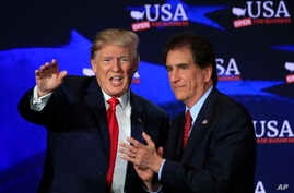 President Donald Trump with Rep. Jim Renacci, R-Ohio, right, waves during a roundtable discussion on tax cuts at Cleveland Public Auditorium and Conference Center in Cleveland, Ohio, May 5, 2018.