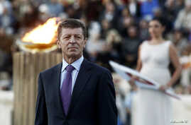 Russia's Deputy Prime Minister Dmitry Kozak attends a handover ceremony of the Olympic flame for the Sochi 2014 Winter Games at the Panathenean stadium in Athens October 5, 2013.