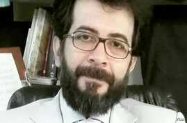 Kamran Ayazi appears in this undated portrait from his Facebook and YouTube pages.
